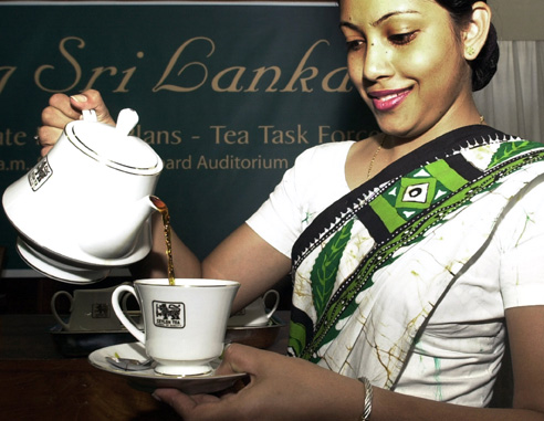 Sri Lanka Tea Board employee Bhagya Weerasooriya pours a cup of