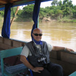 Marco Restelli in navigazione sul Mekong in Laos